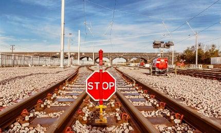 Stop sign on rail tracks